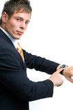Businessman showing watch Royalty Free Stock Photography
