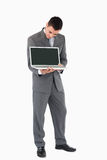 Businessman showing whats on his screen Stock Photo
