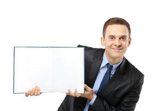 Businessman showing a white blank book Royalty Free Stock Photo