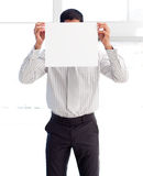 Businessman showing a white card covering his face Royalty Free Stock Image