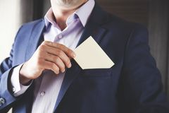 Businessman showing white card in pocket royalty free stock photography