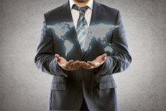 Businessman showing world map Royalty Free Stock Image