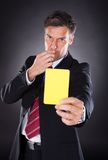Businessman Showing Yellow Card Royalty Free Stock Images
