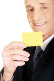 Businessman showing a yellow identity name card Royalty Free Stock Images