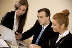 Businessman Showing Young women work Royalty Free Stock Photography