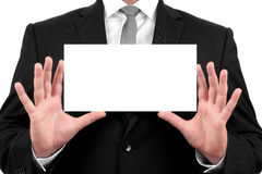 Businessman shows business card with copy space Royalty Free Stock Image