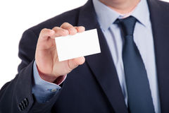 Businessman shows business card, shallow dept of field Royalty Free Stock Images