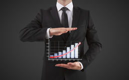 Businessman shows chart Royalty Free Stock Images