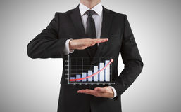 Businessman shows chart Stock Photo