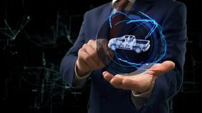 Businessman shows concept hologram 3d Pickup truck on his hand stock video footage