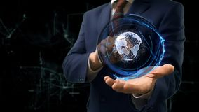 Businessman shows concept hologram Earth on his hand royalty free stock images