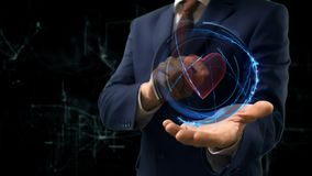 Businessman shows concept hologram Heart on his hand Stock Photo