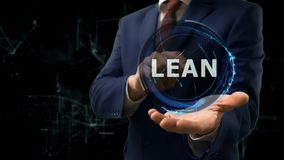 Businessman shows concept hologram Lean on his hand Stock Images
