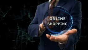 Businessman shows concept hologram Online shopping on his hand. Man in business suit with future technology screen and modern cosmic background Stock Image