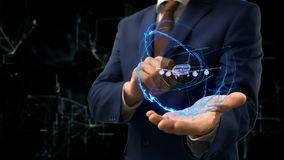 Businessman shows concept hologram Plane on his hand Stock Photo