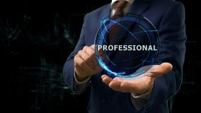Businessman shows concept hologram Professional on his hand. Man in business suit with future technology screen and modern cosmic background Royalty Free Stock Photography