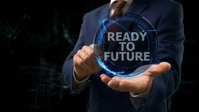 Businessman shows concept hologram Ready to future of internet on his hand. Man in business suit with future technology screen and modern cosmic background Stock Photo