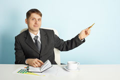 Businessman shows direction Stock Photos