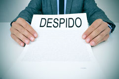 Businessman shows a document with the text despido, dissmissal i Stock Photo