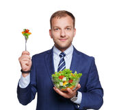 Businessman shows fresh vegetable salad isolated on white Stock Images