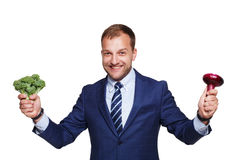 Businessman shows fresh vegetables isolated on white Royalty Free Stock Photography