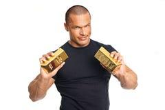 Businessman shows gold brick Royalty Free Stock Photos