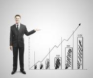 Businessman shows graph Stock Photos