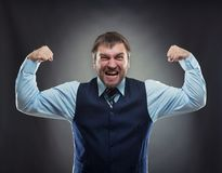Businessman shows his muscles Stock Image