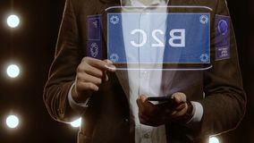 Businessman shows hologram with text B2C