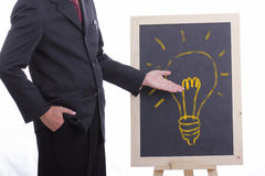 Businessman shows idea Stock Image