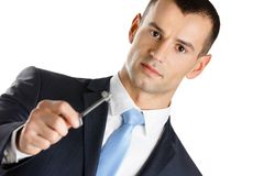 Businessman shows key Stock Photography