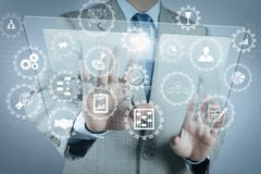 Businessman shows modern technology. AR virtual screen dashboard with project management with icons of scheduling, budgeting, communication.businessman shows Stock Image