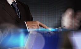 Businessman shows modern technology Stock Photography