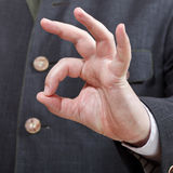 Businessman shows OK sign close up Royalty Free Stock Images