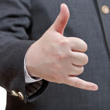 Businessman shows phone call sign - hand gesture Stock Image