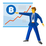 Businessman shows a poster with bitcoin and growing charts. Businessman in blue suit shows a poster with bitcoin sign and growing charts. Growth cryptocurrency Stock Photography