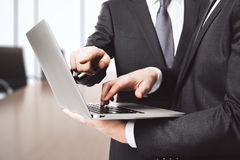 Businessman shows screen of laptop another one in conference roo Royalty Free Stock Photography