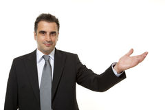 Businessman shows something beside of him Royalty Free Stock Photography