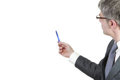 Businessman shows. Something on a white wall with his pen. Isolated on a white background Royalty Free Stock Image