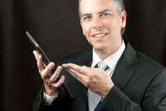 Businessman Shows Tablet Stock Photo