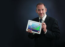 Businessman Shows Tablet PC Screen Royalty Free Stock Photos