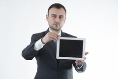 Businessman shows tablet Royalty Free Stock Photography