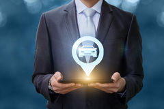 Businessman Shows The Location Of The Car . Royalty Free Stock Image