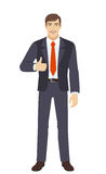 Businessman shows thumb up Stock Photo