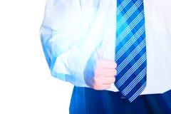 Businessman shows thumb up, symbol of success Stock Photos
