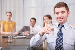 Businessman shows thumbs up Stock Images