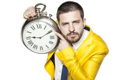 Businessman shows the time on the clock Stock Images