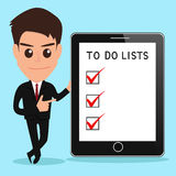 Businessman shows to do lists on tablet screen. Stock Photography