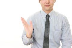 Businessman shows the way. Portrait of an Asian businessman stock photos