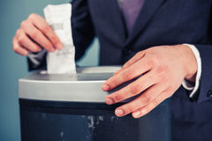 Businessman shredding documents. A Businessman is shredding important documents Stock Photography